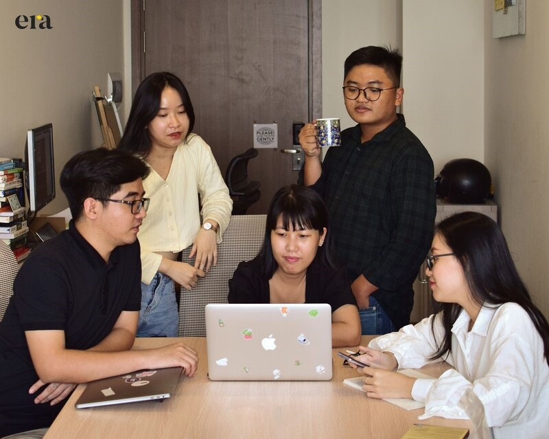 The whole team was reviewing the ongoing projects with the key personnel, Tinh Duong (in a checkered shirt) and Huong Uyen (in a white shirt)